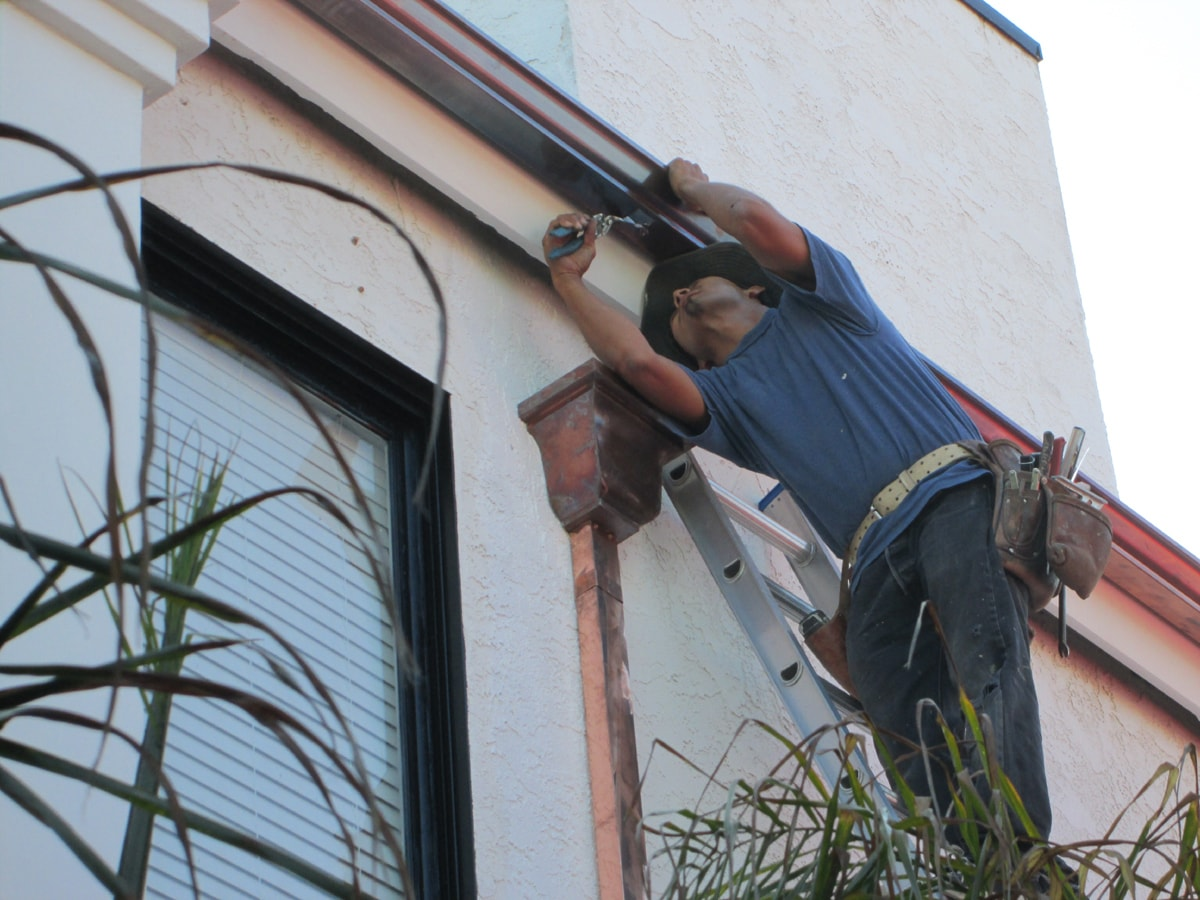 gutter installation- copper leader for downspout