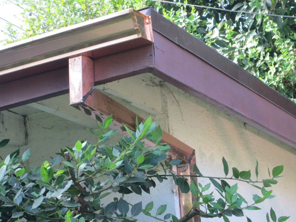 "pasadena - soldering 90 degree elbow -  2""x3"" copper smooth downspout - 5"" OG (K-style) copper gutter"