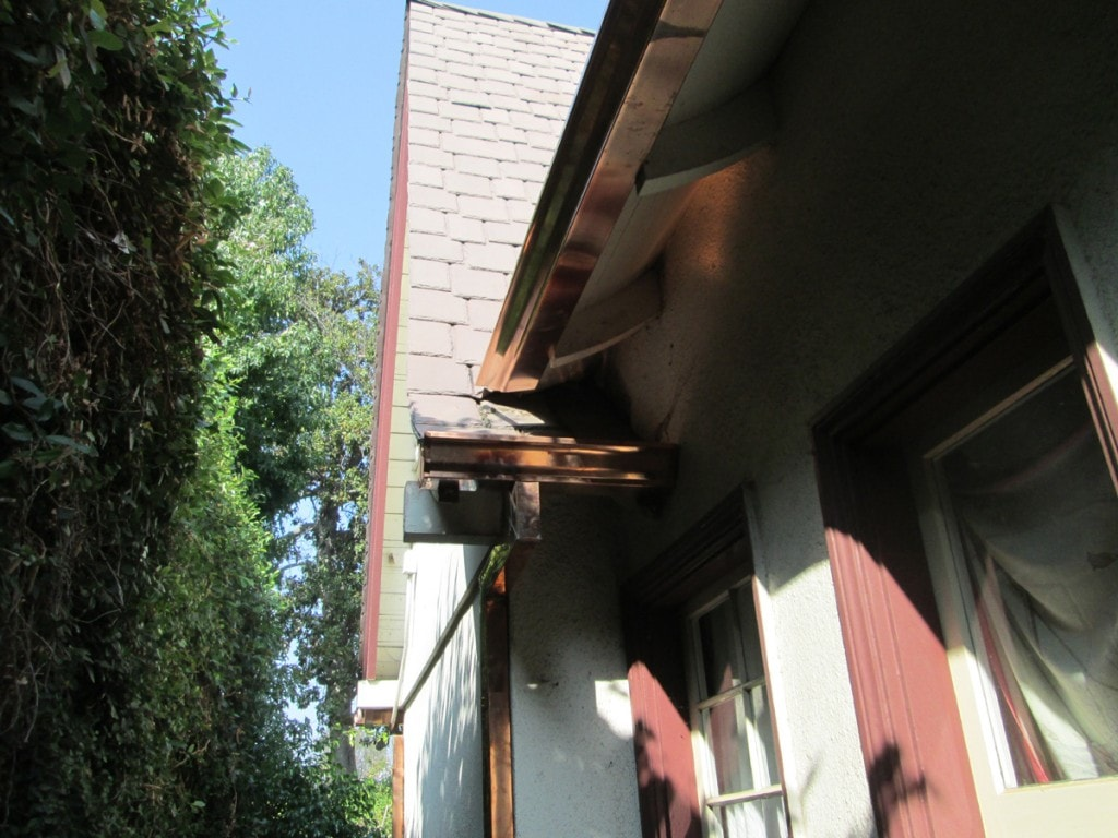 OG k-style copper gutter with downspout - spilling from top gutter - custom work