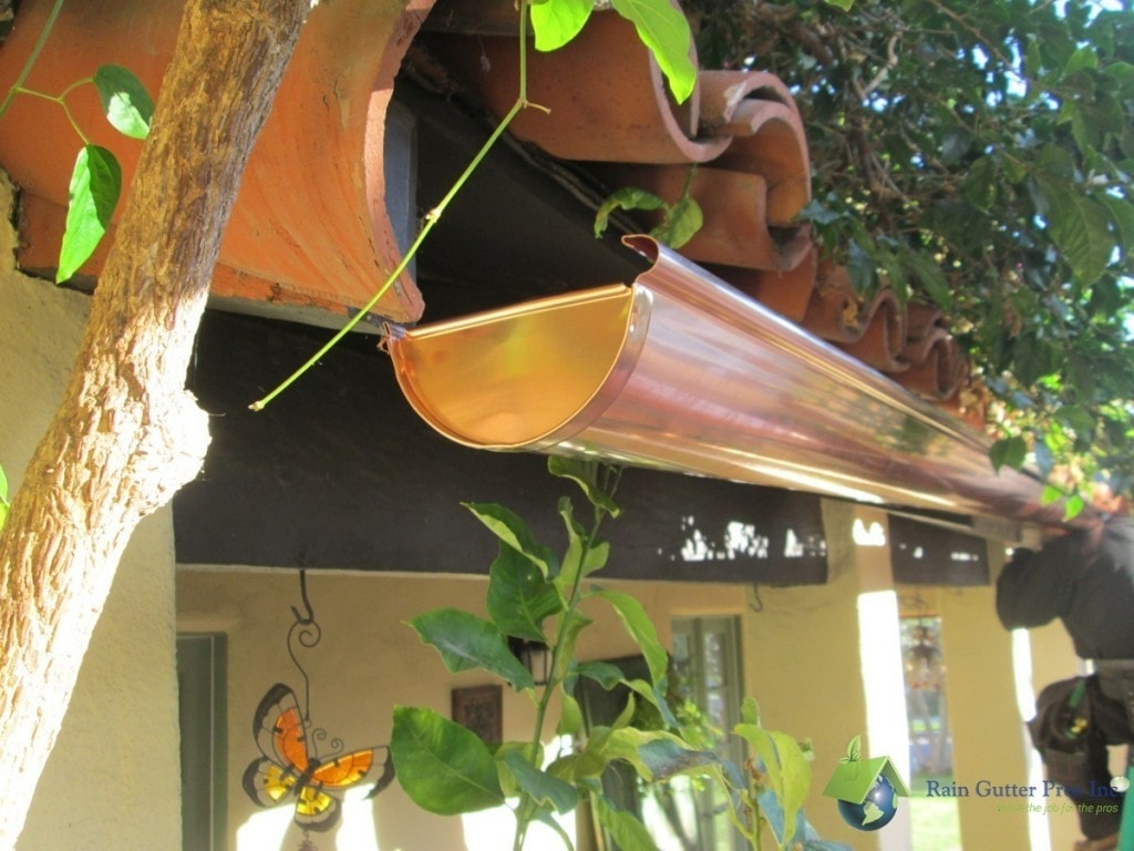 Copper half-round rain gutter installed on mission style