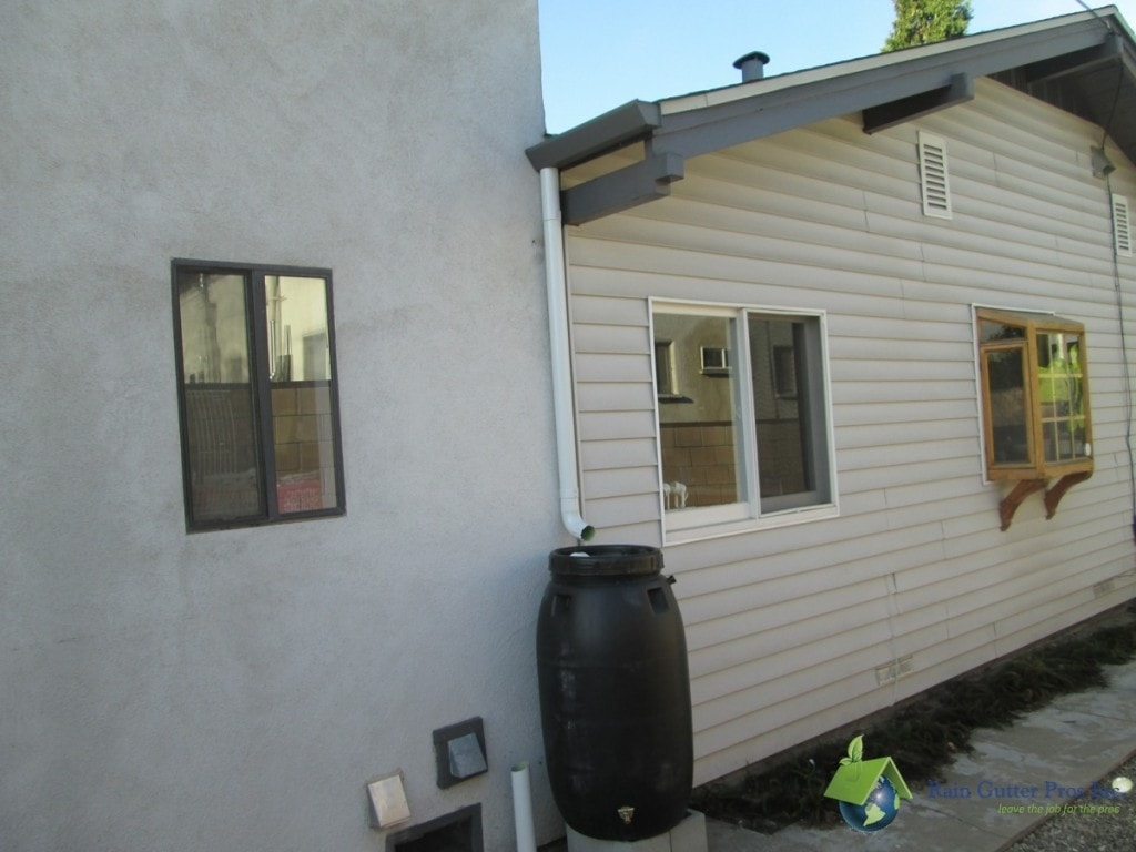 Aluminum downspout with rain barrel installed