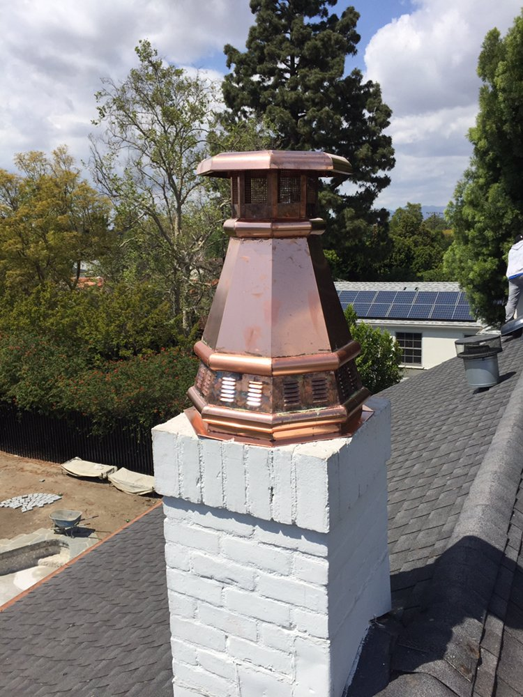 Copper chimney cap installed