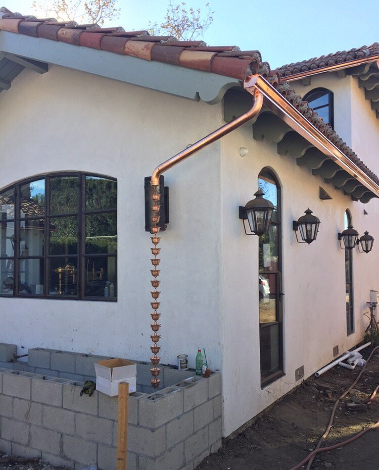 Copper gutters and rain chain on Spanish colonial